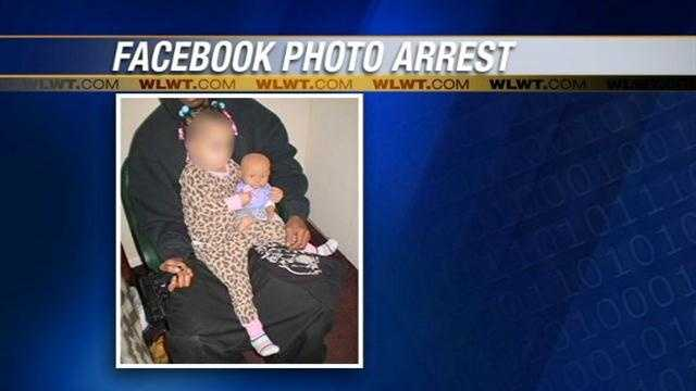 A man is being held on $2,000 bond after he was accused of posting a photo on Facebook that showed him with a baby and a gun.
