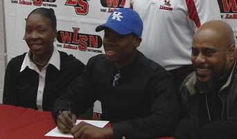 La Salle's Jaleel Hytche signs his letter of intent to play college football for the University of Kentucky.