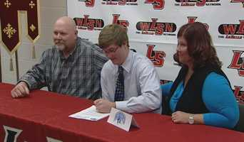 La Salle's Dan Keller signs his letter of intent to play football for Johns Hopkins University.