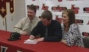 La Salle's Nathan Sparks signs his letter of intent to play college football for Centre College.