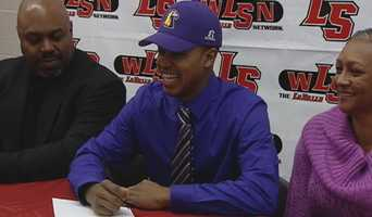 La Salle's Trey Thompson signs his letter of intent to play college football at Tennessee Tech.