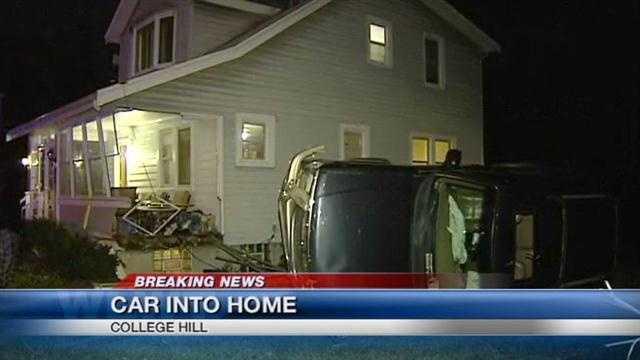 A car hits a house in Cincinnati's Mt. Airy neighborhood.