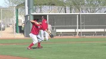 Joey Votto fields a ball.