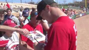 Jay Bruce signs autographs before a game.