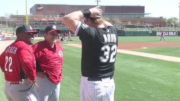 Dusty Baker talks with former Red Adam Dunn for a game.