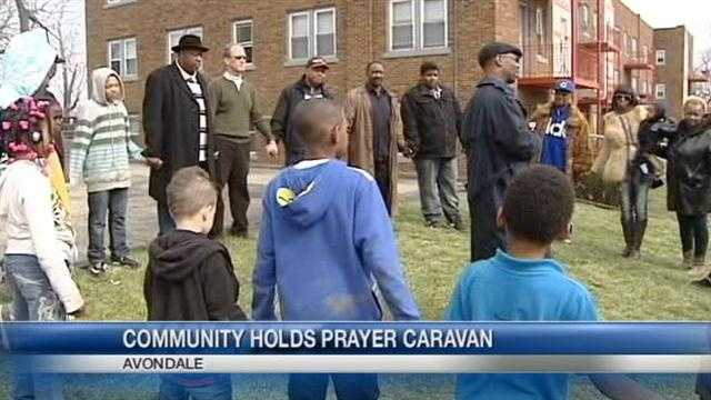 A local group is marching through neighborhoods that have seen their share of deadly violence.