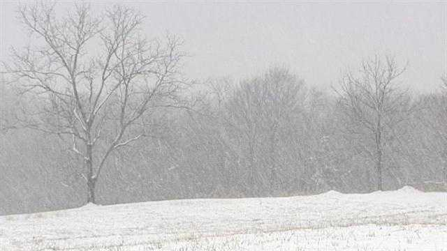 A number of areas in Kentucky are soaked with rain, while others remain blanketed in snow.