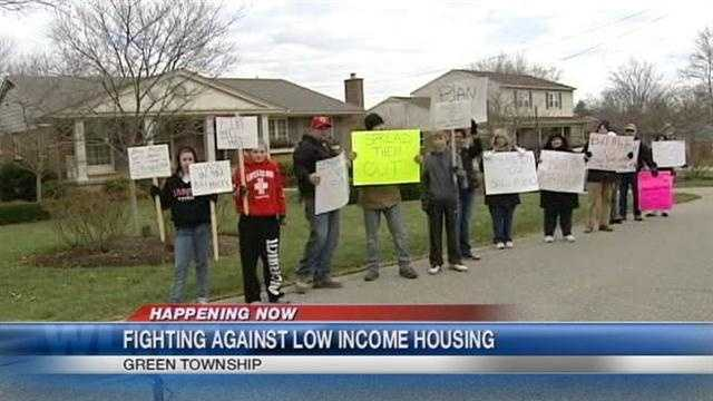 West side residents are protesting again at a Cincinnati Metropolitan Housing Authority board member's home about a housing plan.