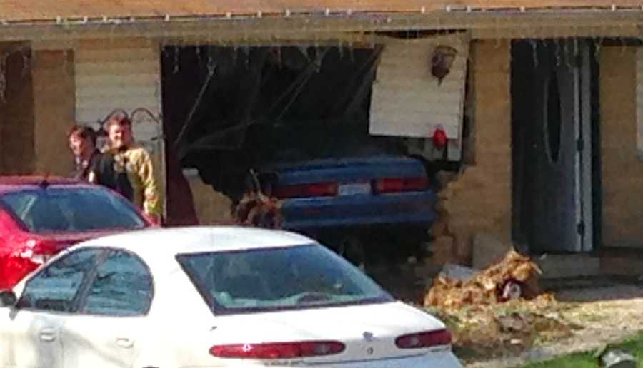 A car drives into the side of a Union Township house.