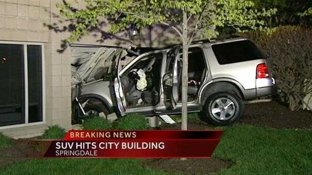 Police are investigating an overnight crash that left an SUV partially inside the Springdale City Building