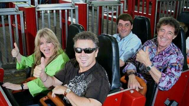 Brady Bunch stars Christopher Knight (front row right), Susan Olsen (front row left) and Barry Williams (second row right) enjoy a ride on the Racer roller coaster at Kings Island on Sunday.