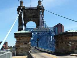 Cincinnati and Covington city leaders held a ribbon cutting ceremony to mark the completion of the Roebling Bridge Pedestrian Connector. The walkway, which runs along the side of the bridge, allows pedestrians to walk from the Cincinnati riverfront into Covington, Ky., without crossing streets or climbing stairs. Officials said it's a great addition to both cities and makes the area more handicap accessible.