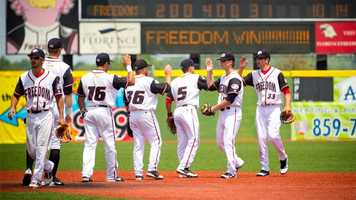 7. Root on the Florence Freedom at a baseball game.