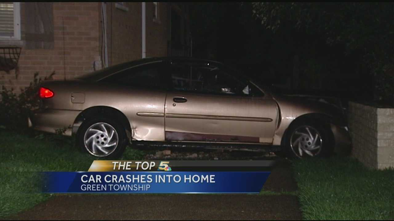 A driver left their car behind after hitting a home early Friday