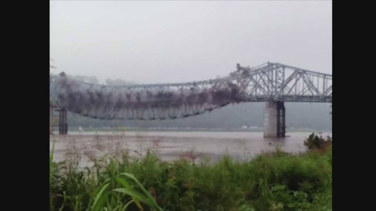 Authorities demolished the Milton-Madison Bridge over the Ohio River Tuesday morning.