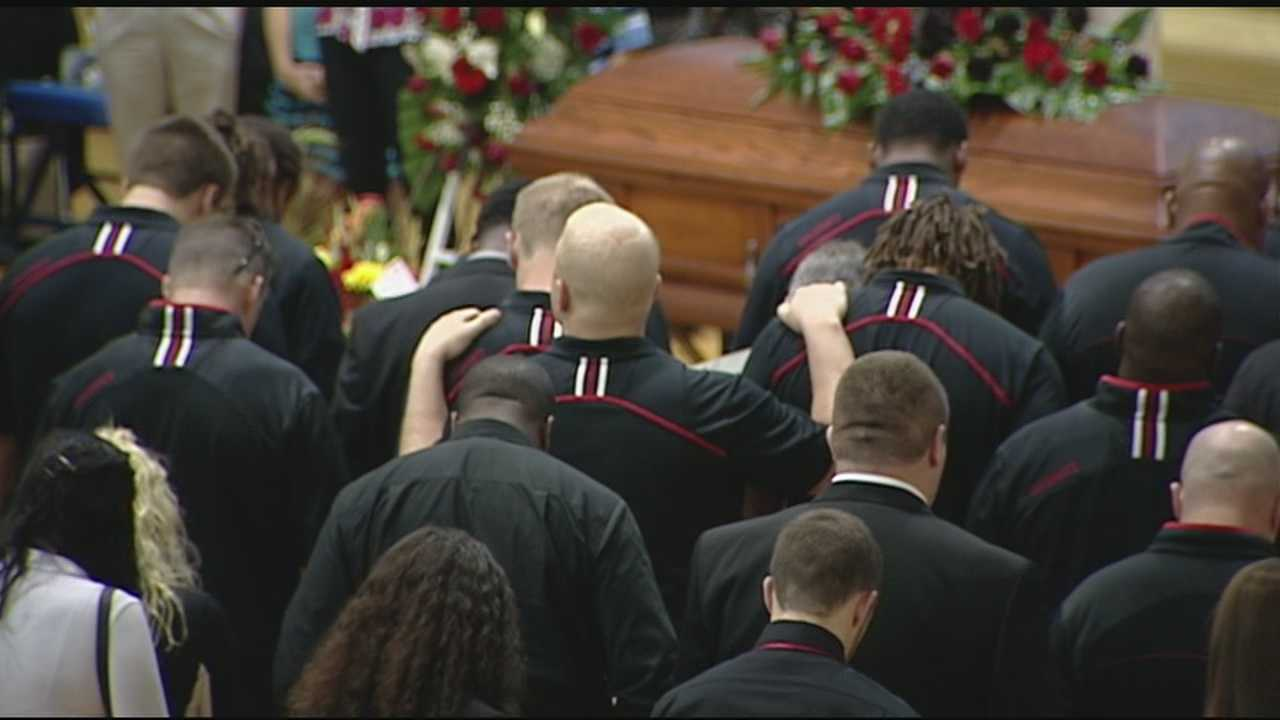 Friends, classmates and loved ones gathered Tuesday night to remember a Hamilton graduate and University of Cincinnati football player killed in a car crash over the weekend.