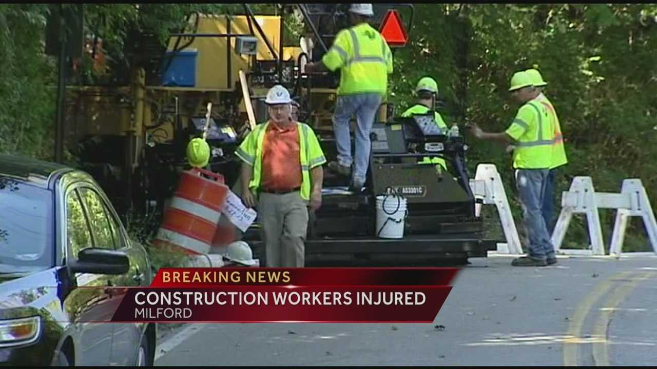 Two construction workers were transported to the hospital after they were struck while working in Milford.