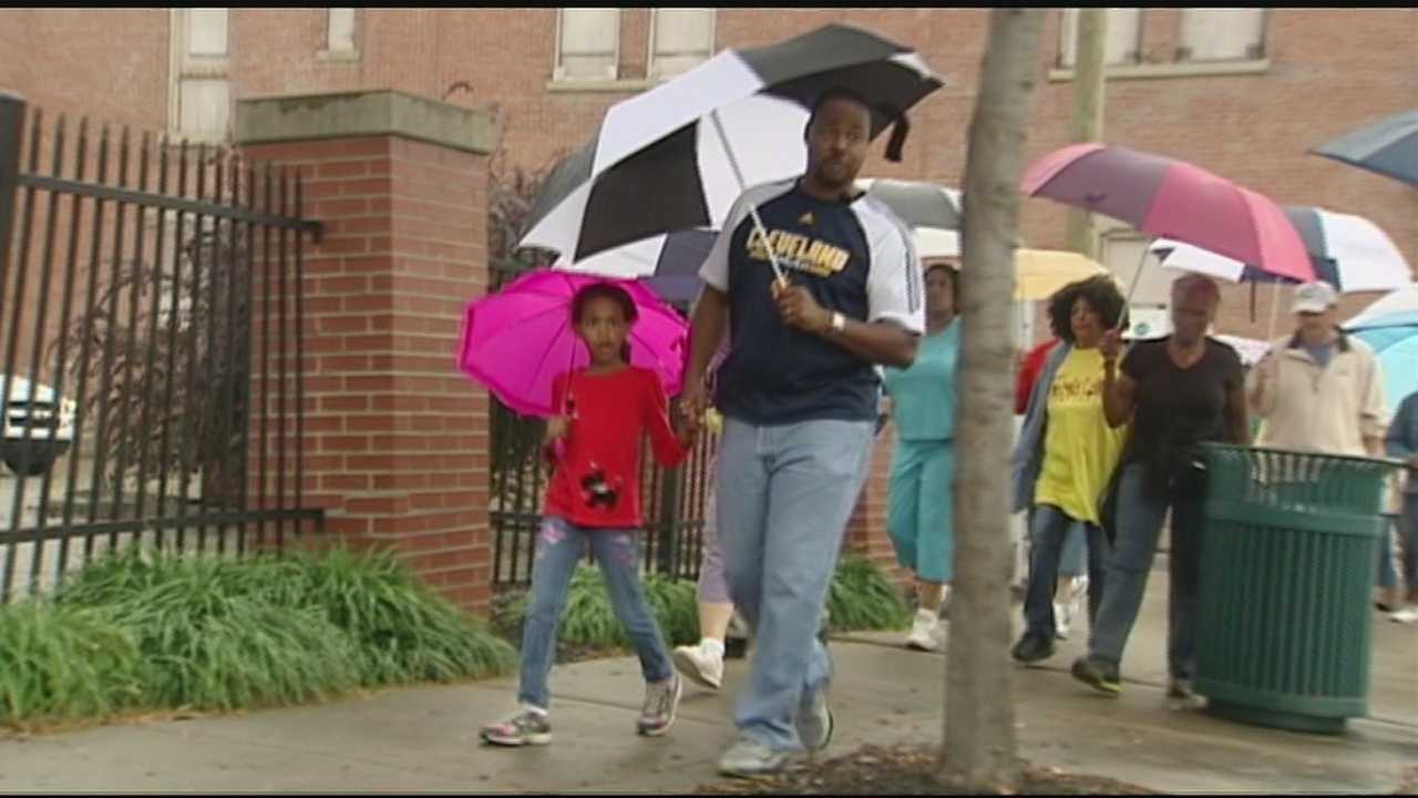 Cincinnati residents joined police officers and church leaders in 14 prayer walks around the city Saturday.