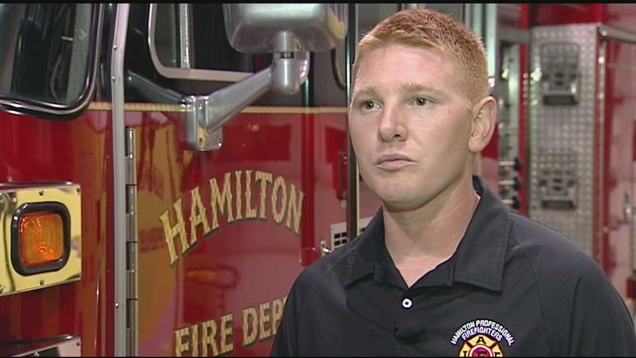 A Hamilton firefighter returning home helped save a man in cardiac arrest at the Jacksonville International Airport.