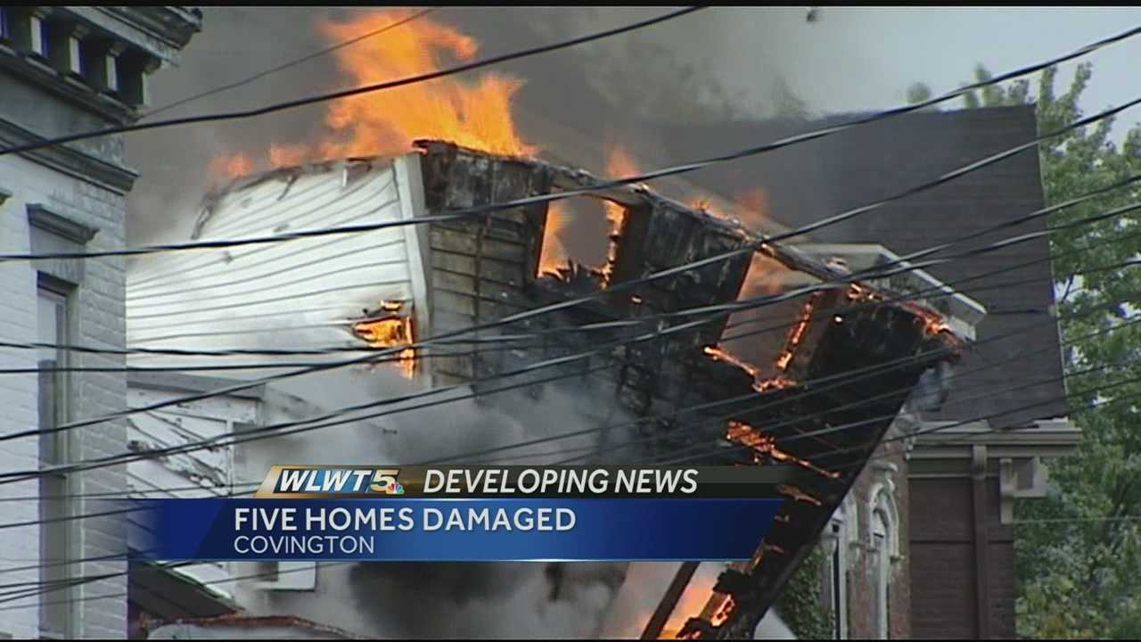 A Thursday evening fire destroyed two homes and damaged three others.