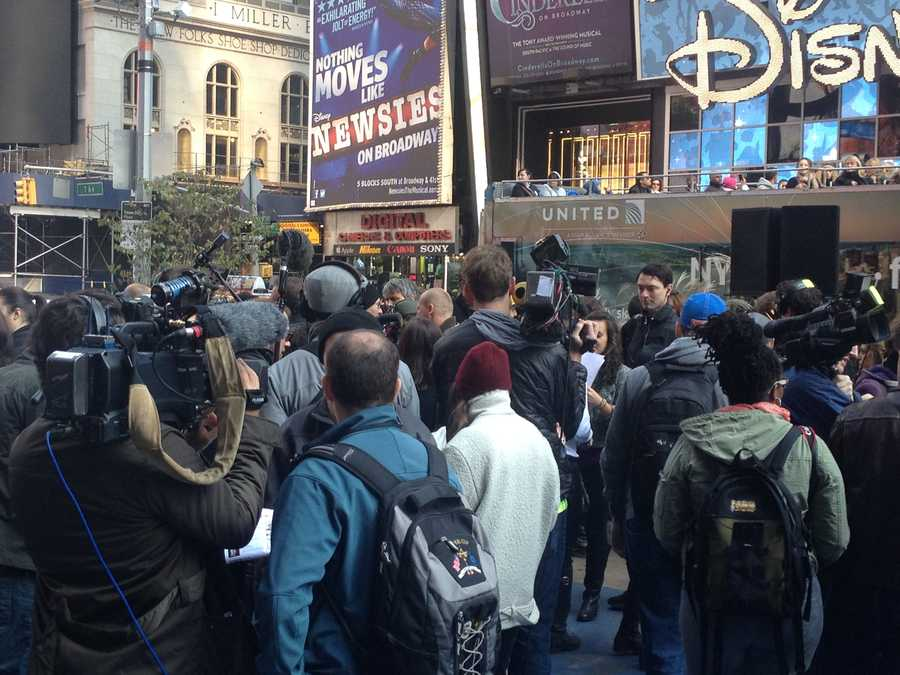 A sea of reporters interview Olympic athletes in Times Square.