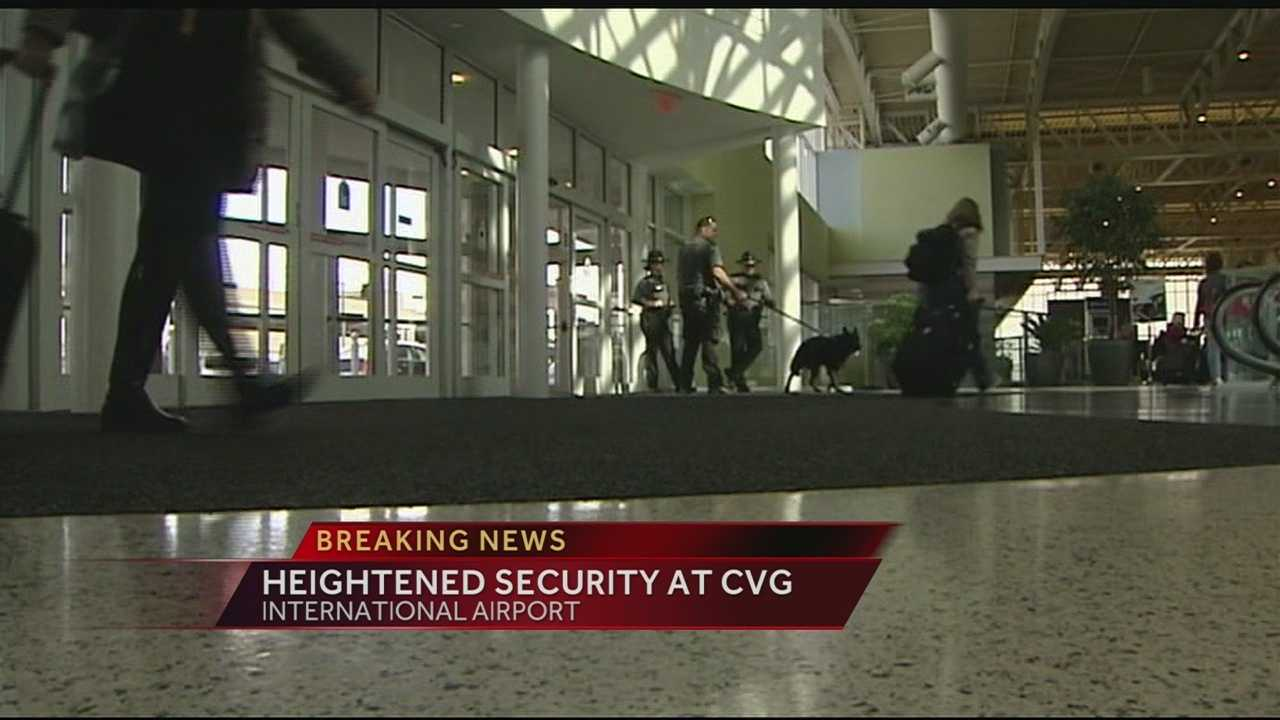Passengers flying from Cincinnati to Los Angeles noticed heightened security after a TSA officer was shot and killed in the terminal.