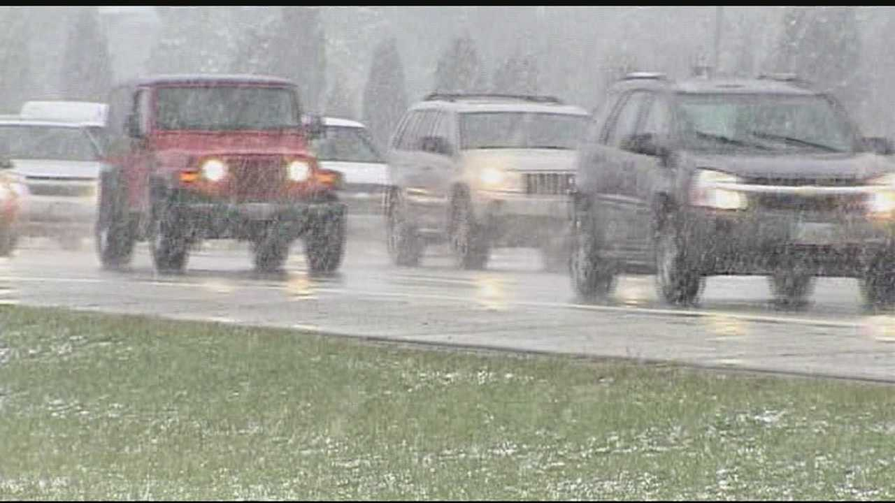 Snow, ice sticks to grass but not on many roads in Tri-State