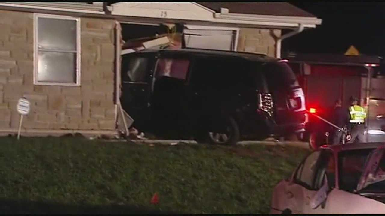 Several people were hurt when a minivan crashed into an apartment building late Wednesday.