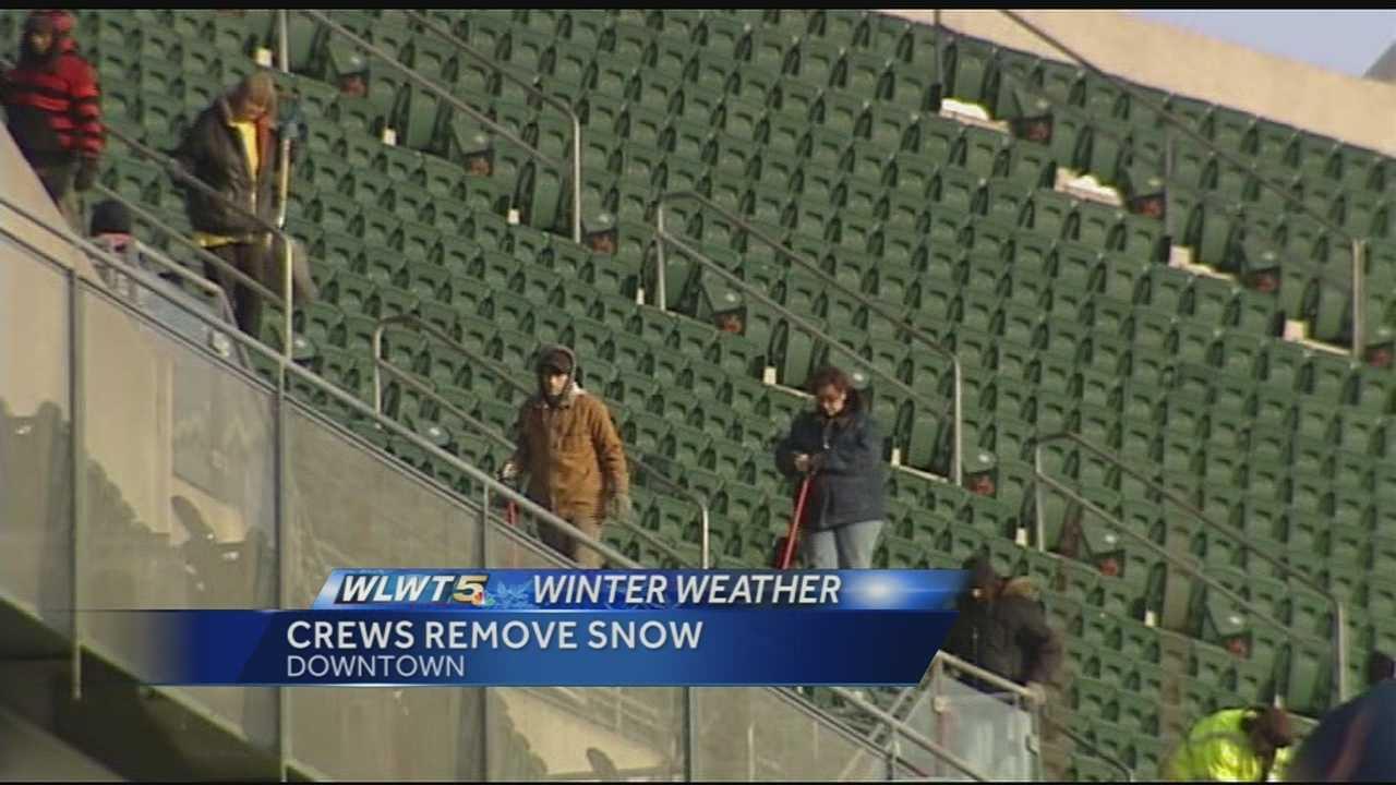 After several inches of snow on Friday, crews were hard at work before the Cincinnati Bengals' home game against the Indianapolis Colts on Sunday.