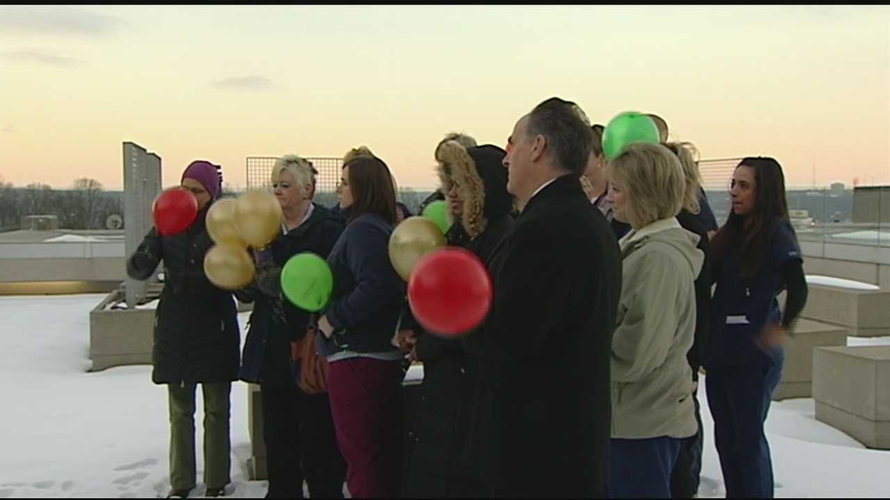 Staff releases balloons in honor of their patients who have died of cancer