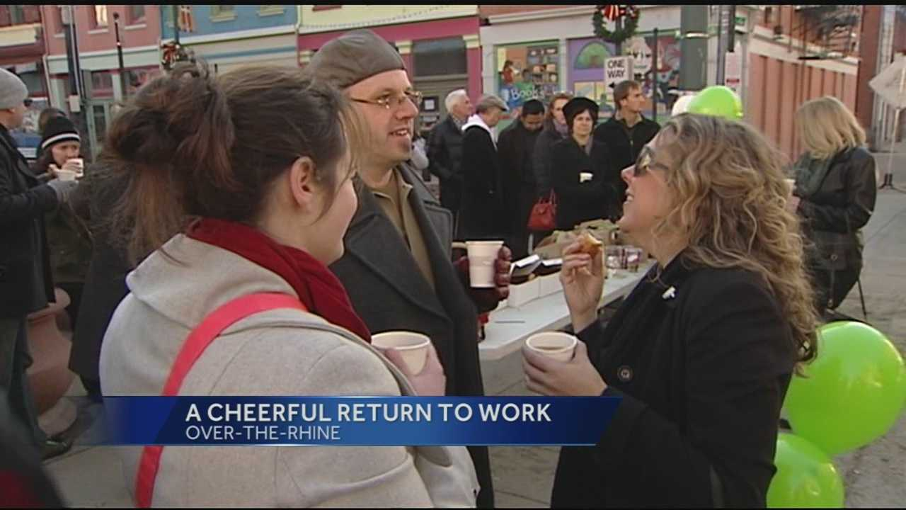 Community and business leaders offered coffee and doughnuts to streetcar construction workers who were back on the job Friday morning.