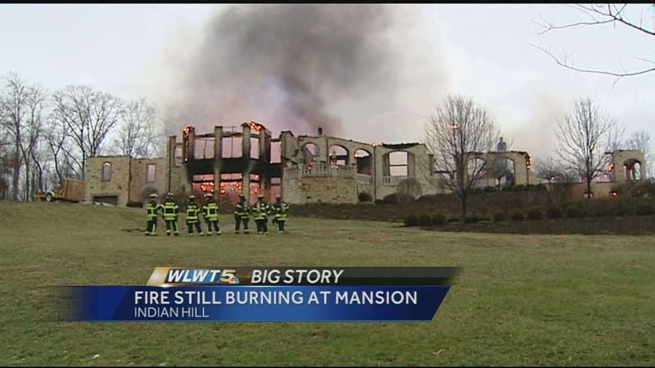 Fire investigators said hotspots were keeping them out of an Indian Hill home 24 hours after a fire nearly leveled it.