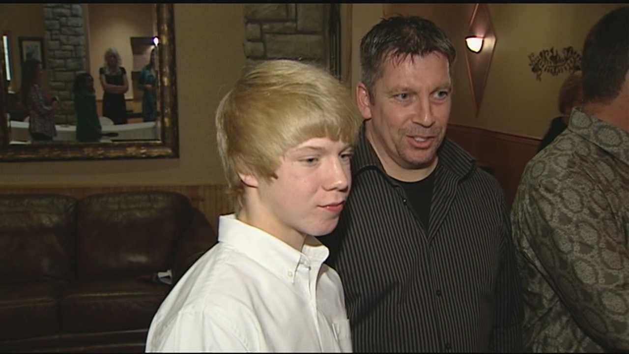 Father, son honored for saving drowning girl