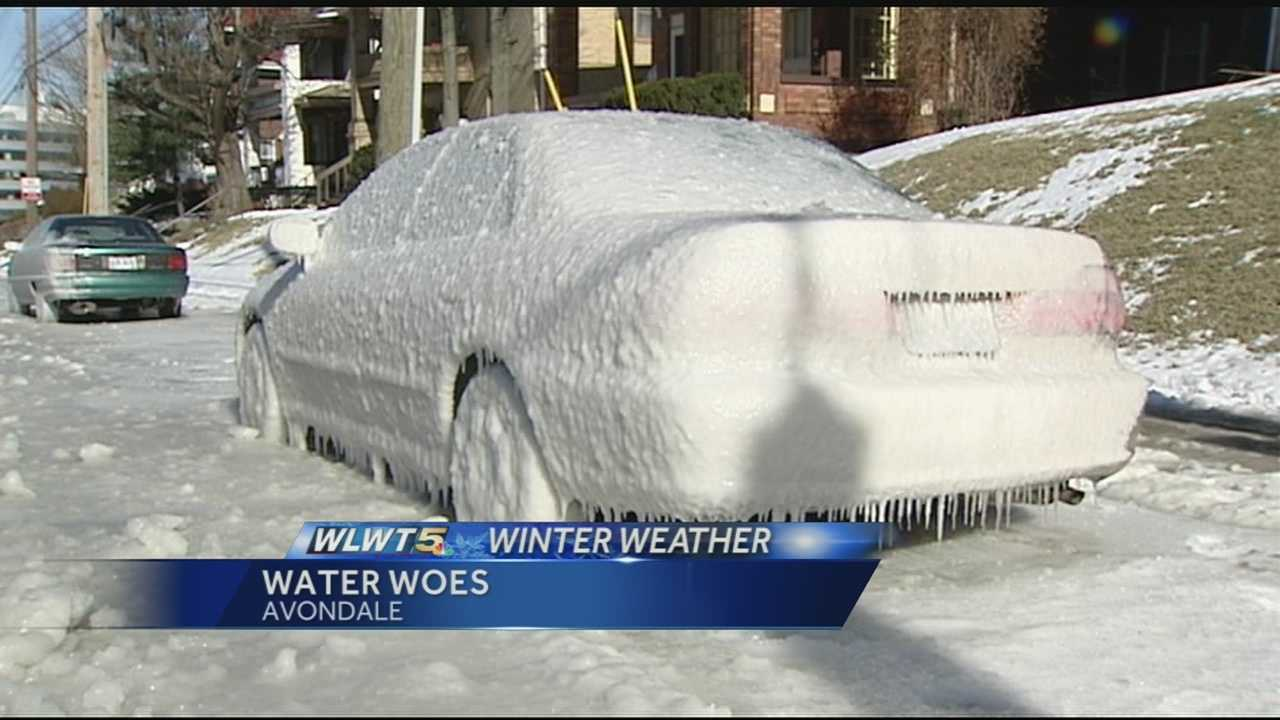 A car encased in ice, just one of many problems caused by water main breaks.