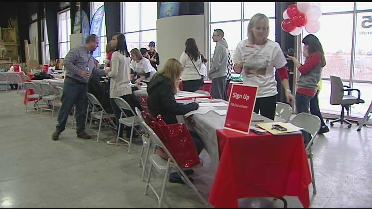 Volunteers get swabbed, give blood at family's benefit