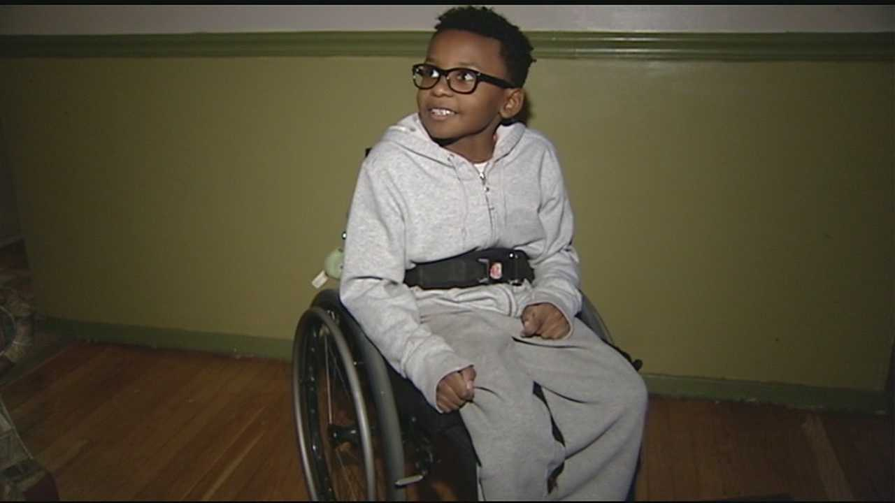 D.J. has been wheelchair-bound most of his young life and uses the wheelchair ramp daily, but now he needs his father to pick him up to get on and off the front porch.