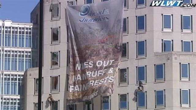 Raw video: Greenpeace activists hang protest banners