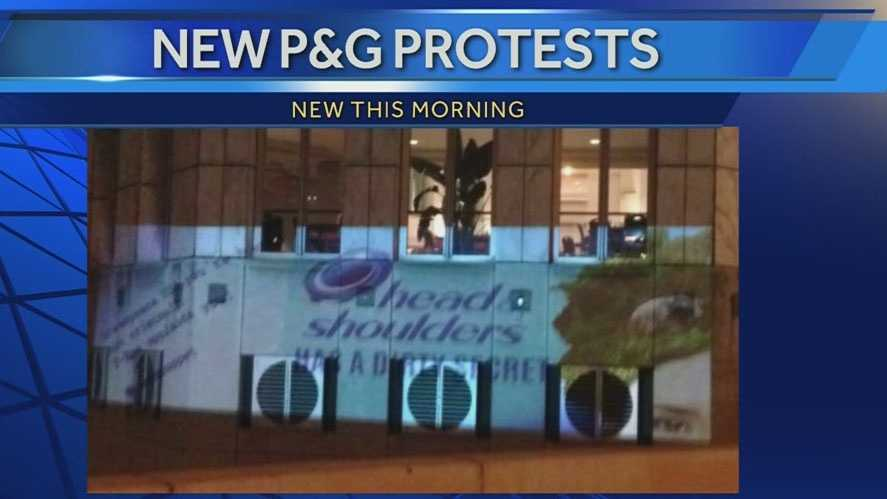 Protest message projected on P&G HQ downtown