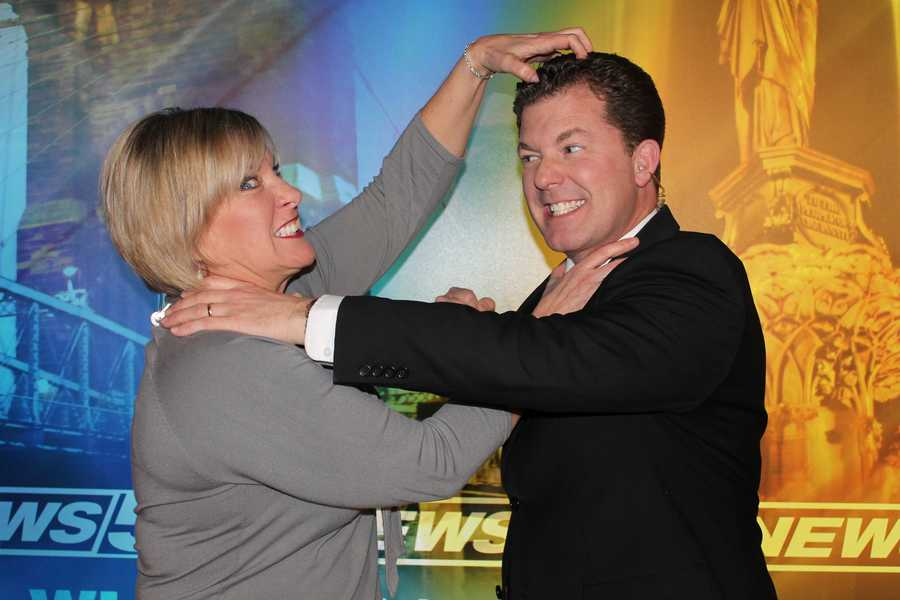 """As you can clearly see in this adorably sweet picture... Lisa Cooney appreciates Todd Dykes' """"salon quality"""" hair. Todd says he likes Lisa's ability to get a grip."""