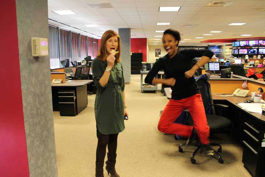 Jackie Congedo says Kristy is the happiest person in the newsroom (the jump says it all). Kristy Davis says she appreciates Jackie's hunger for news (and food).