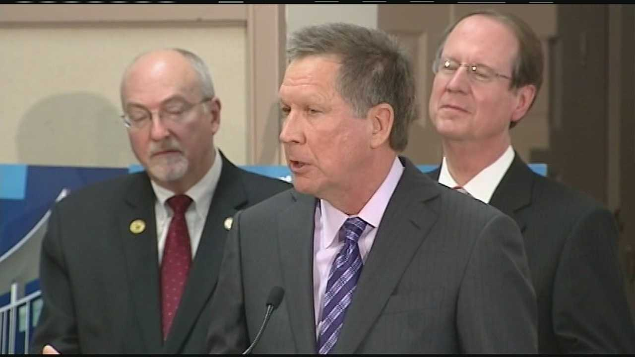 Governor John Kasich made Ohio's budget official by signing it at a school in Columbus on Wednesday.