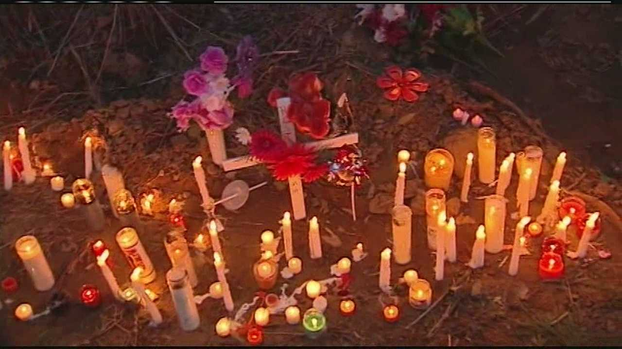 Samantha Ramsey's family and friends held a vigil on River Road in Hebron Sunday night in the spot where she was fatally shot by a Boone County deputy early Saturday morning.
