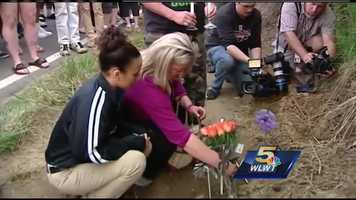 Sunday, April 27, 2014: Ramsey's friends and family members hold a vigil in her memory along River Road. They place candles and a cross at the scene of the shooting.