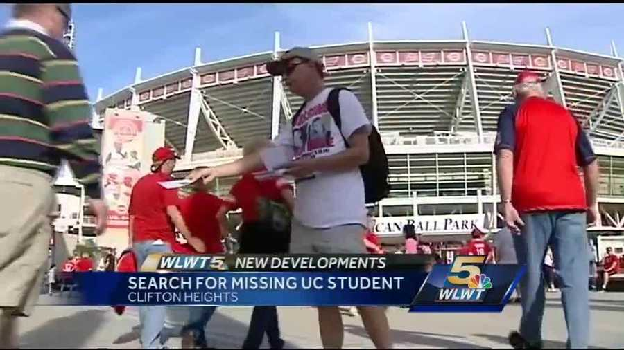 Volunteers distribute missing person fliers outside Great American Ballpark before the Reds-Cardinals game.
