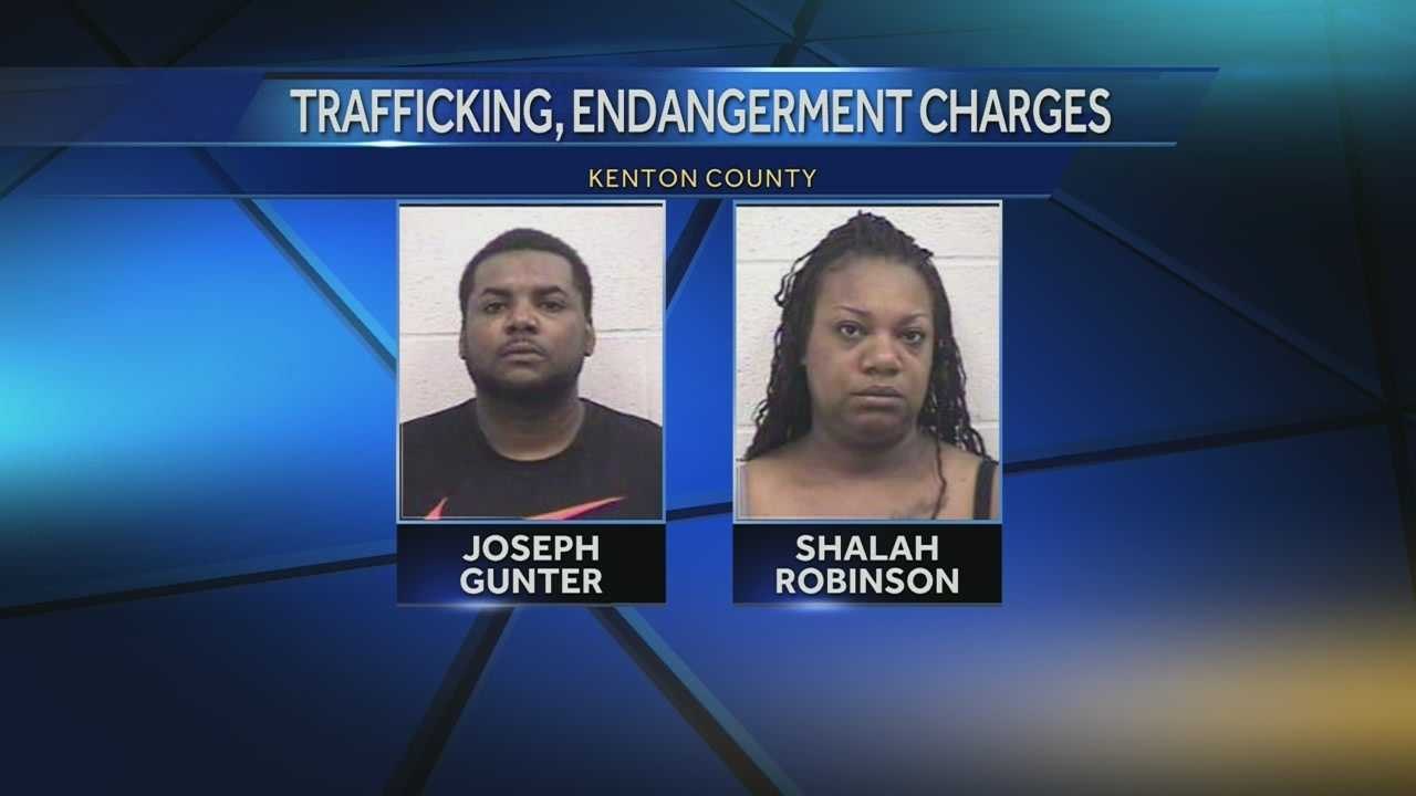Police say a man and woman brought children with them when they made a drug deal.