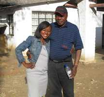 Tammy Mutasa and her dad, Justin, in Zimbabwe in 2012.