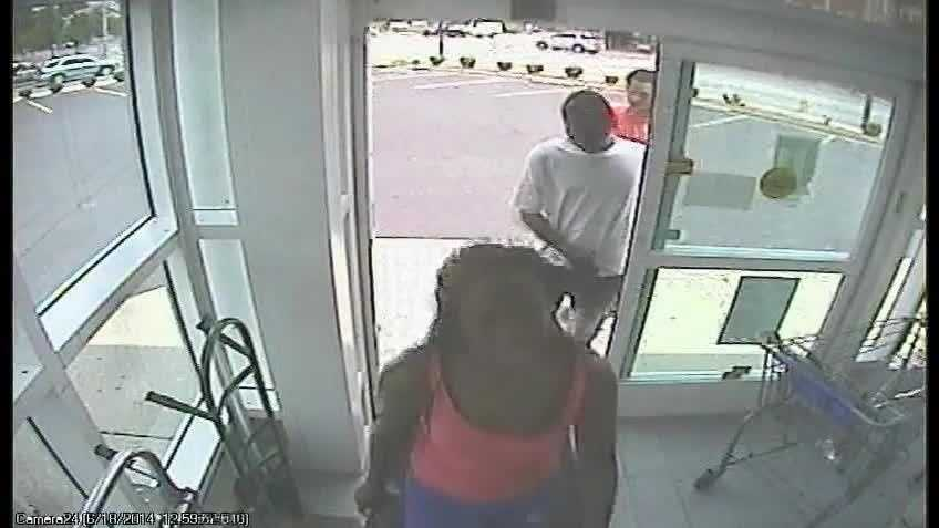 Police say Lashawnda Stevens is the woman in front and Antwan Hocker is in the red shirt at the back in this surveillance photo.