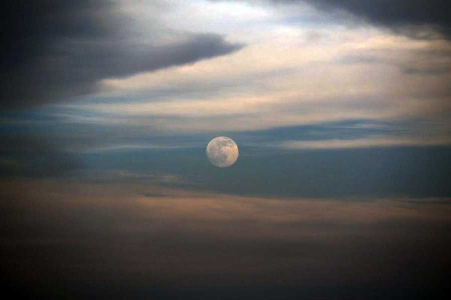Moonrise among storm clouds