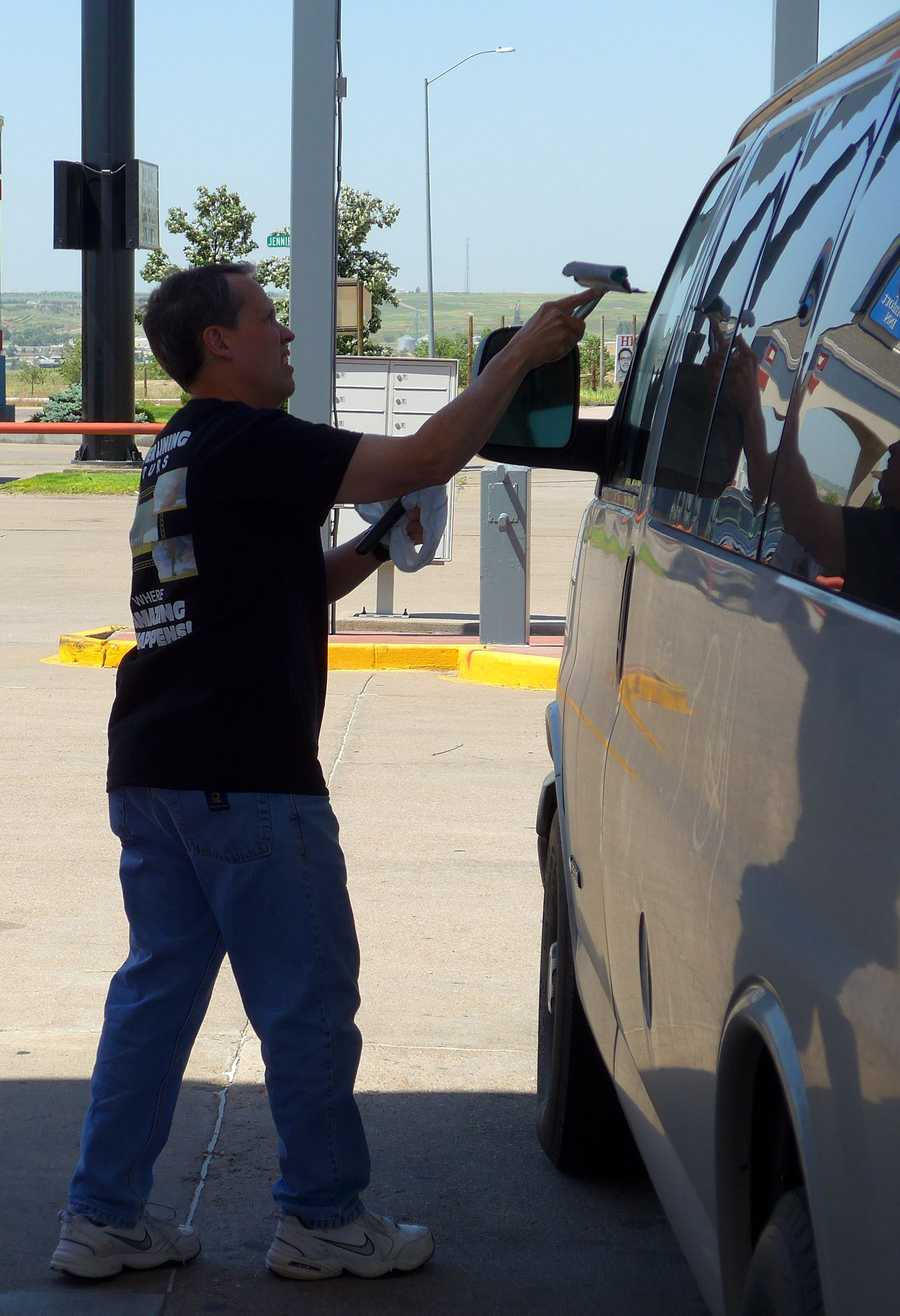 Guests often volunteer to clean van windows during gas stops, in no small part so we can see out of them when the storms form.