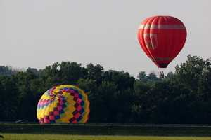 Because of the light winds Monday, balloonists launched from around the airport and tried to hit a target placed on the main runway.